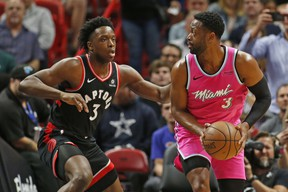 Raptors forward OG Anunoby defends against Miami Heat guard Dwyane Wade during Wednesday night's game. (AP PHOTO)