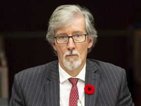 Privacy Commissioner Daniel Therrien waits to appear at the House of Commons information, privacy and ethics committee in Ottawa, Thursday Nov. 1, 2018. THE CANADIAN PRESS/Adrian Wyld