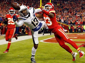 Kansas City Chiefs cornerback Kendall Fuller  breaks up a pass intended for Los Angeles Chargers wide receiver Keenan Allen during the game at Arrowhead Stadium on Dec. 13, 2018 in Kansas City, Mo.