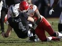Raiders quarterback Derek Carr is tackled by Chiefs linebacker Dee Ford during first half NFL action in Oakland, Calif., Sunday, Dec. 2, 2018.