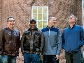 "In this Nov. 16, 2018 photo, Dean Felber, from left, Darius Rucker, Jim Sonefeld, and Mark Bryan, of Hootie & the Blowfish, pose for a portrait at the University of South Carolina in Columbia, S.C. The band is returning with a tour and album 25 years after ""Cracked Rear View"" launched the South Carolina-based rock band. (Sean Rayford/Invision/AP)"