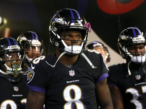 In this Nov. 18, 2018, file photo, Ravens quarterback Lamar Jackson (8) walks in a tunnel to the field as the team is introduced before an NFL game against the Bengals in Baltimore.