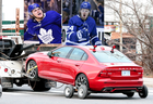 A red volvo gets towed away after forwards William Nylander and Kasperi Kapanen were involved in a minor vehicle collision outside the team's practice facility. According to the Leafs, there were no injuries as a result of the accident in Toronto on Friday December 7, 2018. (Dave Abel/Toronto Sun/Postmedia Network)