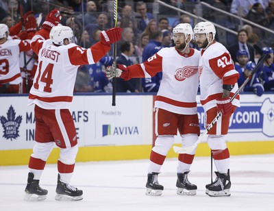 Detroit Red Wings celebrate the fourth goal of the game during the second period in Toronto on Thursday December 6, 2018. Jack Boland/Toronto Sun/Postmedia Network