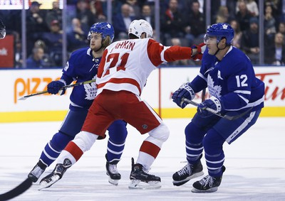 Toronto Maple Leafs William Nylander RW (29) and teammate Patrick Marleau C (12) try to sandwich Detroit Red Wings Dylan Larkin C (71) during the first period in Toronto on Friday December 7, 2018. Jack Boland/Toronto Sun/Postmedia Network