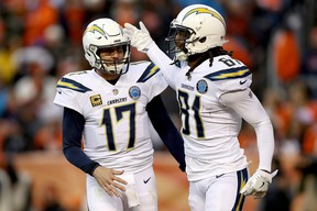 Chargers quarterback Philip Rivers (left) and wide receiver Mike Williams celebrate a touchdown against the Denver Broncos last week. (GETTY IMAGES)