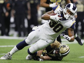 Todd Gurley of the Los Angeles Rams runs the ball against the New Orleans Saints during the fourth quarter  in the NFC Championship game at the Mercedes-Benz Superdome on January 20, 2019 in New Orleans, Louisiana. (Kevin C.  Cox/Getty Images)