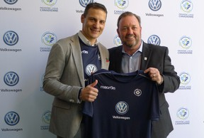 Canadian Premier League commissioner David Clanachan (right) and Volkswagen Group Canada president Daniel Weissland hold up a soccer jersey at a CPL event on Tuesday. (THE CANADIAN PRESS)