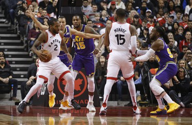 Toronto Raptors Kawhi Leonard SF (2) pushes off in the paint during the first quarter  in Toronto, Ont. on Tuesday January 1, 2019. Jack Boland/Toronto Sun/Postmedia Network