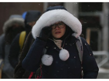 "All bundled up at Yonge and Wellesley Sts. as the first major snowfall of the year to hit Toronto. Environment Canada called it ""hazardous winter conditions"" with snowfall up to 25 centimetres. Temps midday were were -7 C at 4 p.m. but 65 kmh winds made it feel like -18C on Monday January 28, 2019. Jack Boland/Toronto Sun/Postmedia Network"