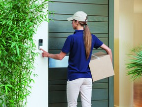 A smart video doorbell allows homeowners to monitor deliveries.