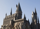 Guests experience the magnificence of Hogwarts castle as it towers above Hogsmeade at The Wizarding World of Harry Potter, at Universal Orlando Resort. (Supplied)