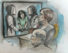 On video: Rehab Dughmosh, resists while being restrained by ICIT team. Justice Kim Crosbie looks on.  Foreground L to R: Federal crown attorney Bradley Reitz, (seated), amicus lawyer Ingrid Grant & interpreter (far right, hidden).  Scarb. Court. August 21, 2017