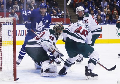 Minnesota Wild Devan Dubnyk G (40) and Toronto Maple Leafs John Tavares C (91) watch the puck slide past the post in the last minute of the third period in Toronto on Thursday January 3, 2019. Jack Boland/Toronto Sun/Postmedia Network