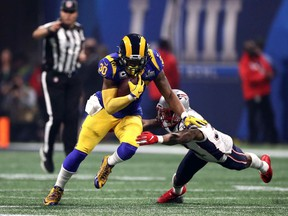 Todd Gurley of the Los Angeles Rams runs the ball against Jonathan Jones #31 of the New England Patriots in the second half during Super Bowl LIII at Mercedes-Benz Stadium on February 03, 2019 in Atlanta, Georgia.