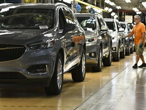 Buicks roll off the line at General Motors' Lansing Delta Township Assembly Plant in Delta Township, Mich.,  on June 19, 2018. (AP photo)