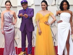 From left to right, Emilia Clarke, Spike Lee, Constance Wu and Regina King pose on the red carpet as they arrive at the Oscars at the Dolby Theatre in Los Angeles on Sunday, Feb. 24, 2019.