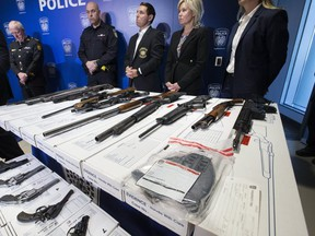 Peel Regional Police provided an overview on Project Baron which resulted in the seizure of a large number of guns, cash and hard drugs. Mississauga Mayor Bonnie Crombie (second from right), and her Brampton counterpart, Patrick Brown (to her right) were present for the press conference. (Stan Behal, Toronto Sun)