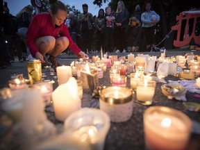 Candles are placed to commemorate victims of Friday's shooting, outside the Al Noor mosque in Christchurch, New Zealand, March 18, 2019. (AP Photo)