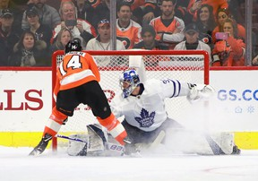 Flyers forward Sean Couturier scores the game-winning goal in the shoot-out against Maple Leafs goalie Frederik Andersen on Wednesday night in Philadelphia. (Bruce Bennett/Getty Images)