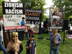 Signs displayed at the Toronto al-Quds day rally on Saturday, June 9 2018.