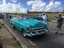 Tourists rush to snap pictures of a vintage Chevy during a visit to El Morro fortress. Classic cars are one of Cuba's signature sights. Many have been restored for use as tourist taxis. Visitors will also see vintage Ladas in Old Havana, but the boxy Russian-built autos are not nearly as attractive as the American-built beauties. ROBIN ROBINSON PHOTO