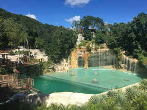 Swing along a zip line next to a waterfall at Scape Park. (Cynthia McLeod)