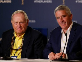 Golf legend Jack Nicklaus (left) and PGA Tour Commissioner Jay Monahan (right) speak to the media during a practice round for The Players Championship on The Stadium Course at TPC Sawgrass in Ponte Vedra Beach, Fla., on Wednesday, March 13, 2019.