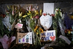 Mourners place flowers as they pay their respects at a makeshift memorial near the Masjid Al Noor mosque in Christchurch, New Zealand, on Saturday, March 16, 2019. (AP Photo/Vincent Thian)