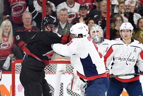 Alex Ovechkin #8 of the Washington Capitals knocks out Andrei Svechnikov #37 of the Carolina Hurricanes as they fight during the first period in Game Three of the Eastern Conference First Round during the 2019 NHL Stanley Cup Playoffs at PNC Arena on April 15, 2019 in Raleigh, North Carolina. (Photo by Grant Halverson/Getty Images)