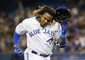 Toronto Blue Jays rookie Vladimir Guerrero Jr. reacts to a long flyout against the Oakland Athletics during the fourth inning of MLB baseball action in Toronto, Friday April 26, 2019. THE CANADIAN PRESS/Mark Blinch