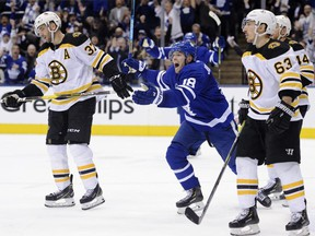Bruins top-liners Patrice Bergeron (left) and Brad Marchand (right) look on while Leafs' Andreas Johnsson celebrates his goal in Game 3. THE CANADIAN PRESS