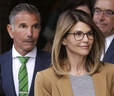 Trouble in paradise? Lori Loughlin, front, and husband, clothing designer Mossimo Giannulli, leave a Boston courthouse. THE ASSOCIATED PRESS files