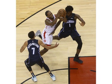 Toronto Raptors Kawhi Leonard SF (2) is double teamed by Orlando Magic Jonathan Isaac PF (1) and teammate  Michael Carter-Williams PG (7) during the fourth quarter  in Toronto, Ont. on Wednesday April 17, 2019. Jack Boland/Toronto Sun/Postmedia Network