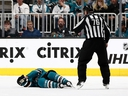 Joe Pavelski of the San Jose Sharks lies on the ice after a hard hit at SAP Center on April 23, 2019 in San Jose. (Ezra Shaw/Getty Images)