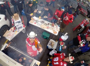 Sheldon Jones offers up a smokie at the CFL Horsemen Tailgate party at the Edmonton Eskimos/Calgary Stampeders CFL 2014 West Final at McMahon Stadium in Calgary, Alberta, on Nov. 23, 2014.