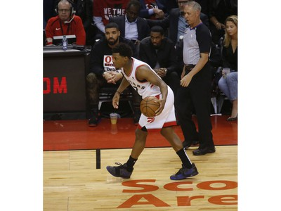 Toronto Raptors Kyle Lowry PG (7) brings the ball up the court past Drake during the first half in Toronto, Ont. on Tuesday April 23, 2019. Jack Boland/Toronto Sun/Postmedia Network