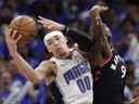 Orlando Magic's Aaron Gordon grabs a rebound away from Toronto Raptors' Serge Ibaka during the second half in Game 4 of a first-round NBA basketball playoff series, Sunday, April 21, 2019, in Orlando, Fla.