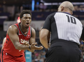 Toronto Raptors' Kyle Lowry, left, argues for a call with referee Ron Garretson (10) during the second half of the team's NBA basketball game against the Charlotte Hornets in Charlotte, N.C., Friday, April 5, 2019. (AP Photo)