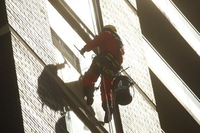 Sky High Windows Services employee Francis descends a 40-storey apartment building, near Islington Ave. and Bloor St. W., with ease using Rope Access safety technology on Wednesday, April 17, 2019. (Jack Boland/Toronto Sun/Postmedia Network)