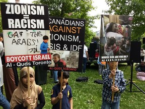 Signs displayed at an al-Quds Day rally at Queen's Park on June 9 2018. (Courtesy Canada-Israel Friendship Association)