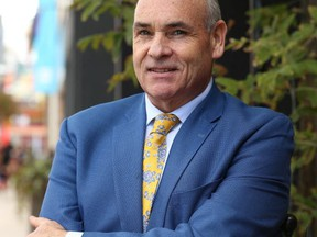 George Smitherman poses while running for city council last fall. (Jack Boland, Toronto Sun)