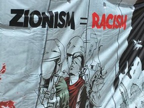 One of numerous anti-Zionist banners flown during an al-Quds day rally at Queen's Park  on June 9 2018. ( Joe Warmington, Toronto Sun)