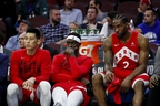 Raptors' Jeremy Lin (left), Pascal Siakam (centre) and Kawhi Leonard look dazed and confused on the bench during the late stages of Game 6 against the 76ers on Thursday night in Philadelphia. Game 7 goes Sunday night in Toronto.(AP PHOTO)