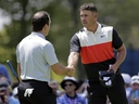 Brooks Koepka, right, shakes hands with Francesco Molinari, after finishing the first round of the PGA Championship at Bethpage Black in Farmingdale, N.Y., Thursday, May 16, 2019.