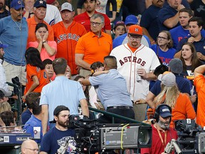 A young child is rushed from the stands after being injured by a hard foul ball off the bat of Albert Almora Jr. of the Chicago Cubs in the fourth inning at Minute Maid Park on May 29, 2019 in Houston, Texas.