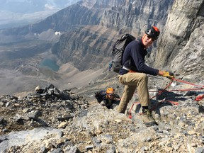 Yamnuska Mountain Adventures guide Richard Howes ropes up Rosanne Drescher on the most technical part of Mount Temple's ascent on Sept. 7, 2018. Most of the hike can be done on two legs, but guides know the safest route to the top of the 3,543-metre peak in Banff National Park near Lake Louise, Alta.