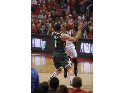 Toronto Raptors Kyle Lowry PG (7) fouled by Milwaukee Bucks Brook Lopez C (11) during the first half in Toronto, Ont. on Tuesday May 21, 2019. Jack Boland/Toronto Sun/Postmedia Network