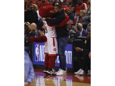 The Raptor hugs Drake during the first half in Toronto, Ont. on Tuesday May 21, 2019. Jack Boland/Toronto Sun/Postmedia Network