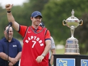 Rory McIlroy of Northern Ireland wears a Toronto Raptors jersey after he won the RBC Canadian Open at Hamilton Golf and Country Club on June 09, 2019 in Hamilton, Canada. (Photo by Michael Reaves/Getty Images)
